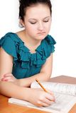 Pretty teen schoolgirl studying for school Royalty Free Stock Photos