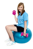Pretty teen seated on a blue pilate ball Royalty Free Stock Photography