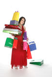 Pretty teen with shopping bags. Pretty teen loaded down with shopping bags and boxes and one dropped Royalty Free Stock Photo