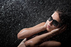 Pretty teen in shower in sunglasses Royalty Free Stock Photo