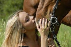 Pretty teen and stallion Stock Photo