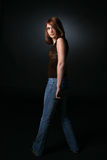 Pretty teen standing and slightly turning Stock Images