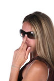 Pretty teen in sunglasses flipping the bird. Pretty teen in sunglasses with her middle finger up Stock Photos