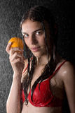 Pretty teen in water studio with orange. Portrait of pretty teen in water studio with orange Stock Photos