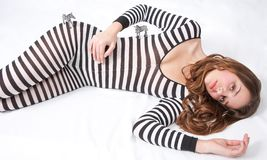 Pretty Teen in Zebra Bodysuit with Toy Zebras Stock Photos