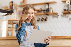Pretty teenage barista making business calls Royalty Free Stock Images