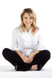Pretty teenage blond sitting Stock Images