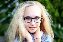 Free Pretty Teenage Girl 14-16 Year Old With Curly Long Blonde Hair And In Glasses In The Green Park In A Summer Day Outdoors. Stock Photos - 181733753
