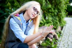 Free Pretty Teenage Girl 14-16 Year Old With Curly Long Blonde Hair And In Glasses In The Green Park In A Summer Day Outdoors. Royalty Free Stock Images - 185125699