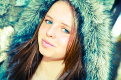 Pretty Teenage Girl. Happy and beautiful teenage girl with bright blue eyes royalty free stock images