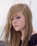 Pretty teenage girl. Pretty blond teen girl looks into the camera looking almost gothic Royalty Free Stock Images