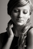 Pretty Teenage Girl against Grey Royalty Free Stock Image