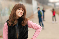 Pretty teenage girl with best friends Royalty Free Stock Image