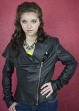 Pretty teenage girl in black leather jacket Royalty Free Stock Images