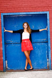 Pretty Teenage Girl Blue Door Royalty Free Stock Photo