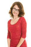 Pretty teenage girl with braces in red dress smiling. A pretty smiling teenage brunette girl with braces and wearing glasses in a red dress against a white Royalty Free Stock Photo