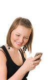 Pretty teenage girl with cellphone. Smiling. White background Royalty Free Stock Image