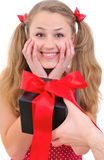 Pretty teenage girl is delighted with present Stock Images