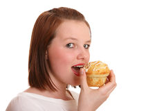 Pretty teenage girl eating cake Stock Photos