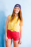 Pretty teenage girl in fashionable clothes. Stock Photos