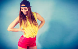Pretty teenage girl in fashionable clothes. Royalty Free Stock Photography
