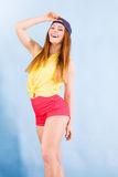 Pretty teenage girl in fashionable clothes. Royalty Free Stock Photo