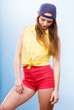 Pretty teenage girl in fashionable clothes. Royalty Free Stock Photos