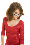 Pretty teenage girl with glasses looking down Stock Photography