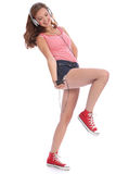 Pretty teenage girl has fun dancing to music Stock Photography