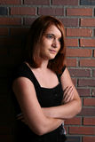 Pretty teenage girl with her arms crossed Royalty Free Stock Photo