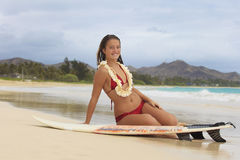Pretty teenage girl with her surfboard Stock Photos