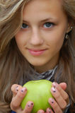 Pretty teenage girl holding an apple Stock Image