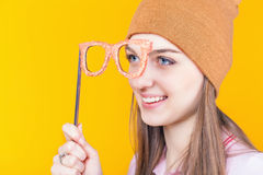 Pretty teenage girl holding masquerade glasses for party Stock Photo