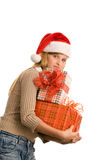 Pretty teenage girl holding pile of gifts Stock Photography
