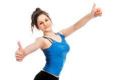Pretty teenage girl holding thumbs up gesture. Royalty Free Stock Photos