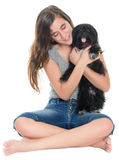 Pretty teenage girl hugging her pet dog Royalty Free Stock Photography