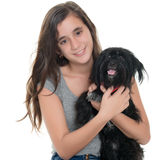 Pretty teenage girl hugging her pet dog Stock Photos