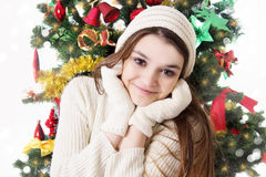 Pretty teenage girl in knitted mitten and hat royalty free stock photo