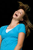 Pretty teenage girl laughing. A pretty teenage girl laughs joyfully stock photo