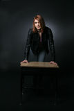 Pretty teenage girl leaning on school desk Royalty Free Stock Photography