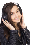 Pretty teenage girl  listening music on her headphones Royalty Free Stock Photos