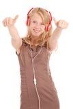 Pretty teenage girl listening music on her headphones Stock Images
