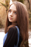 Pretty teenage girl looking upwards in an outdoor setting Royalty Free Stock Image