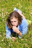 Pretty teenage girl lying in grass. Outdoor portrait of teenage girl Stock Photography