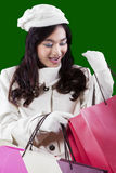 Pretty teenage girl opens gift bags Royalty Free Stock Photo