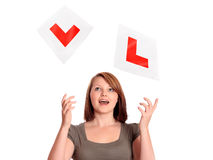 Pretty teenage girl passing her driving test Stock Image