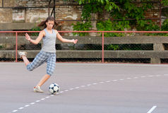 Pretty teenage girl playing football Royalty Free Stock Photos