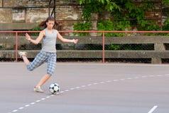 Pretty teenage girl playing football Royalty Free Stock Photos
