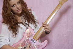 Pretty teenage girl playing guitar Stock Image