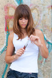 Pretty teenage girl playing with knife Royalty Free Stock Photography